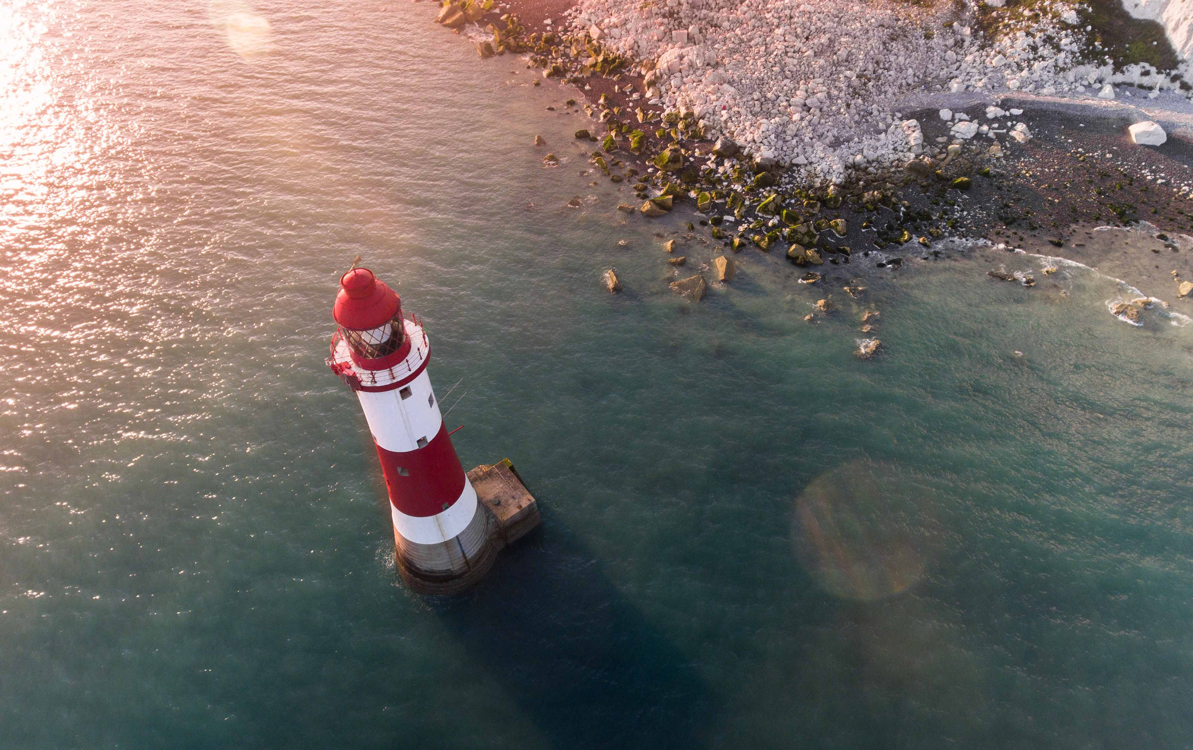 lighthouse and white cliffs photographed by drone